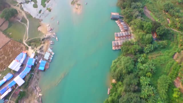 tourist boats and floating markets on the quayson river, ban gioc waterfall, viet nam - off the beaten path stock videos & royalty-free footage