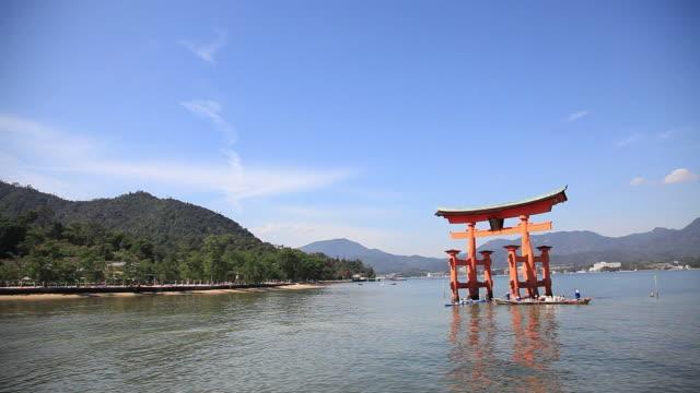 WS Tourist boats moving  near torii gate / Itsukushima, Hiroshima, Japan