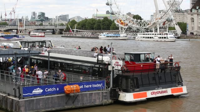 tourist boats on the river thames in london, uk. - barge stock videos & royalty-free footage