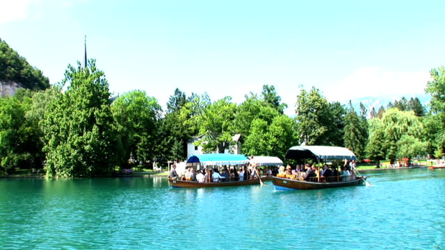 hd: tourist boats - lake bled stock videos & royalty-free footage