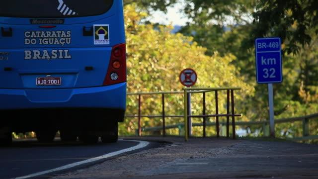 ms tourist bus from catarataâ´s park and kilometer sign / foz do iguacu, parana, brazil - kilometre stock videos & royalty-free footage