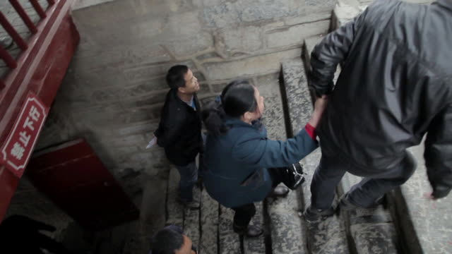 ms ts tourist climbing stairs at god of medicines temple fair during chinese spring festival / tongchuan, shaanxi, china - animal representation stock videos and b-roll footage