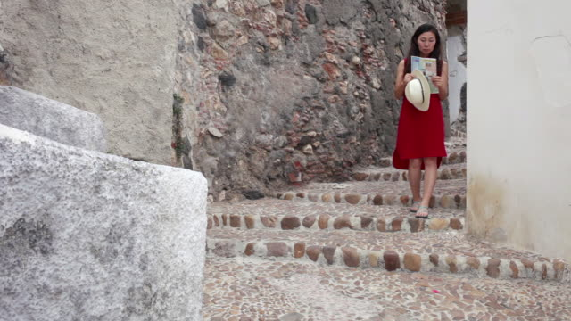 tourist coming down the stairs in a old town - one mature woman only stock videos & royalty-free footage