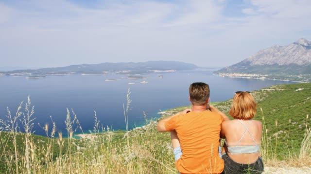 WS Tourist couple enjoying sunny scenic ocean view,Korcula Island,Croatia