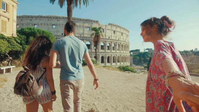 pov tourist couple in rome: follow me - rome italy stock videos and b-roll footage
