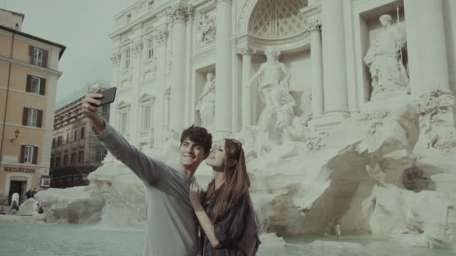 tourist couple taking a selfie in rome - fountain stock videos and b-roll footage