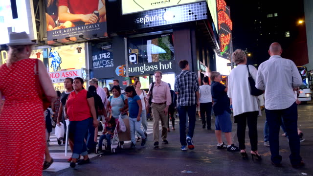 Tourist crossing the street in Times Square, New York City