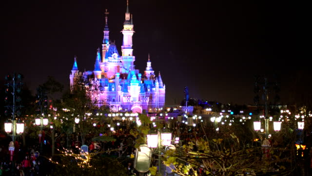 tourist crowd in shanghai disney resort during chinese new year holiday - moated castle stock videos and b-roll footage