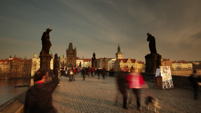 tourist crowds on charles bridge - charles bridge stock videos & royalty-free footage
