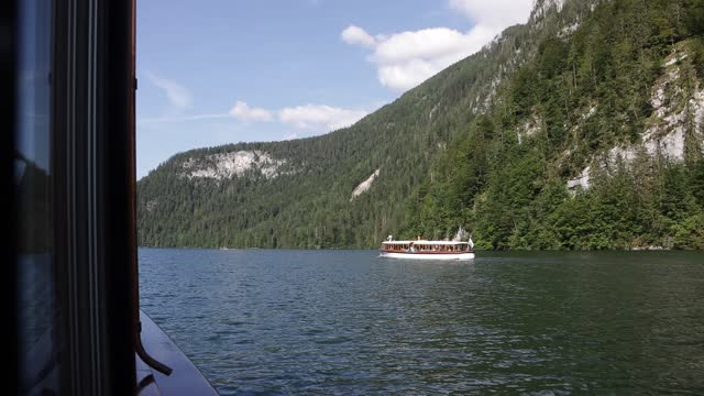 tourist electric boat at konigssee lake on august 09, 2021 in schönau am königssee, germany. königssee lake located in the berchtesgaden national... - tranquil scene stock videos & royalty-free footage