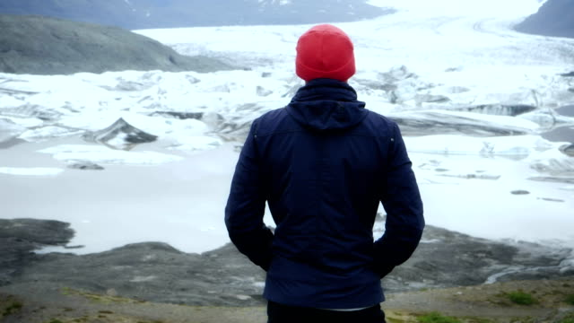 tourist enjoying amazing view. glacier lagoon - lagoon stock videos and b-roll footage