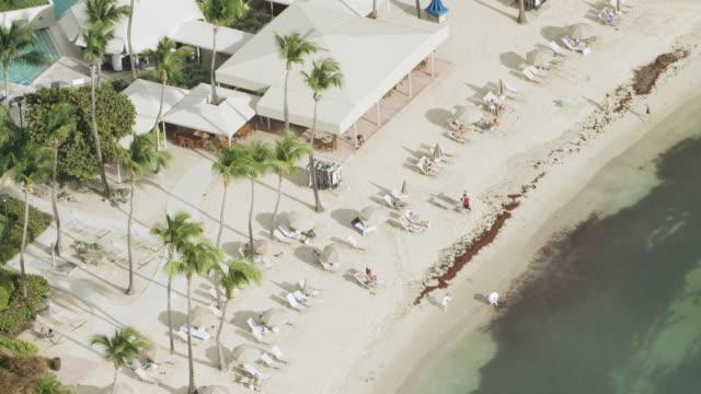 ws aerial pov tourist enjoying at beach in cruz bay / saint john, us virgin islands, united states - st. john virgin islands stock videos & royalty-free footage