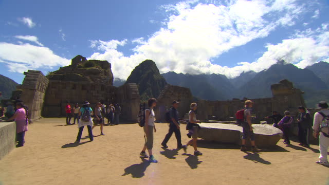 tourist enjoying Machu Picchu