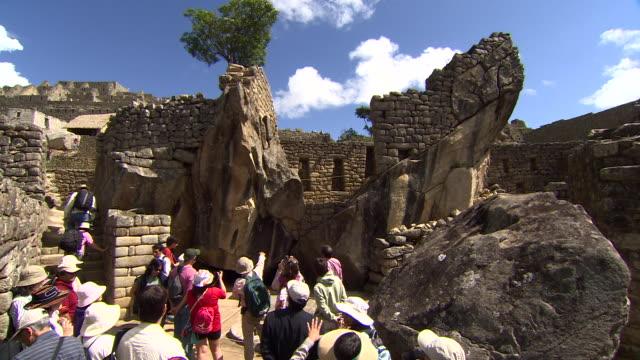 tourist enjoying Machu Picchu