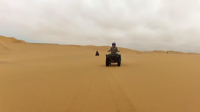 ms pov tourist enjoying terrain vehicles driving in desert / windhoek, namibia - quadbike stock videos & royalty-free footage
