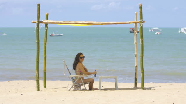 tourist enjoying the summer on japaratinga beach in alagoas, brazil - uv protection stock videos and b-roll footage