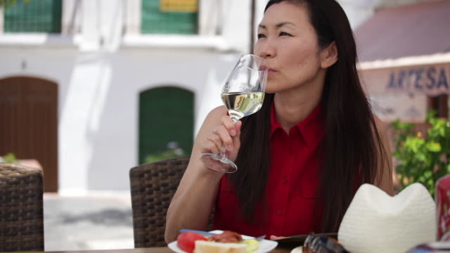 Tourist enjoys a glass of wine in Spain