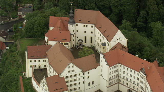 aerial zi tourist entering into colditz castle, colditz, saxony, germany - saxony stock videos & royalty-free footage