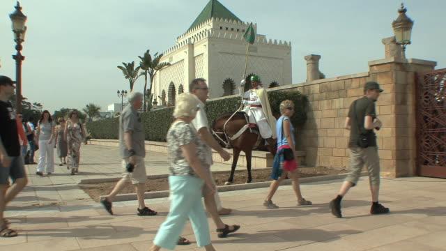 WS Tourist entering Yacoub Al mansour Esplanade past royal guards, Rabat, Morocco