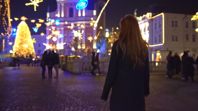Tourist exploring christmas in Ljubljana, Slovenia at night