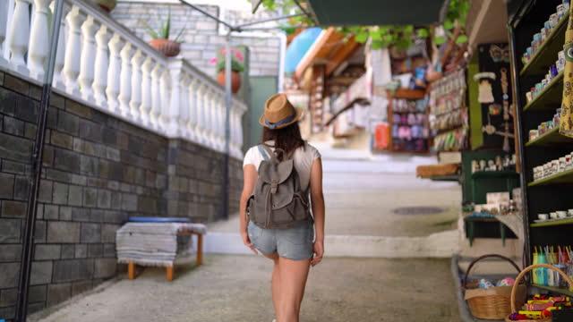 tourist exploring street of parga - rucksack stock videos & royalty-free footage