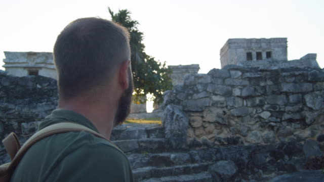 a tourist exploring the tulum mayan ruins. quintana roo, mexico - archaeology stock videos & royalty-free footage