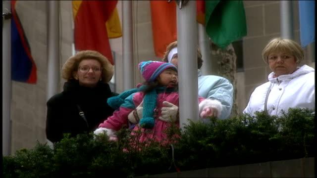 tourist families at rockefeller center - rockefeller center christmas tree stock videos & royalty-free footage