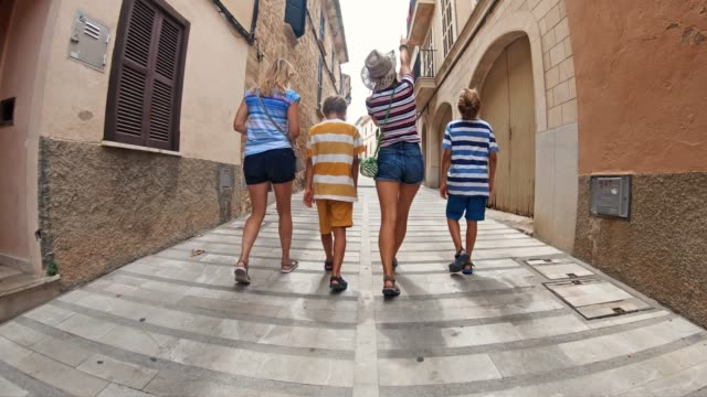 tourist family visiting spanish mediterranean town - narrow stock videos & royalty-free footage