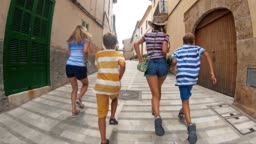 Tourist family visiting Spanish mediterranean town