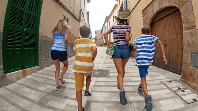 tourist family visiting spanish mediterranean town - tourism stock videos & royalty-free footage