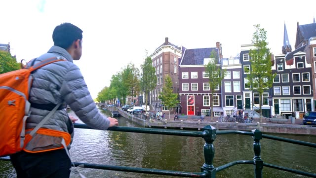 tourist famous place at amsterdam netherlands - riding stock videos & royalty-free footage