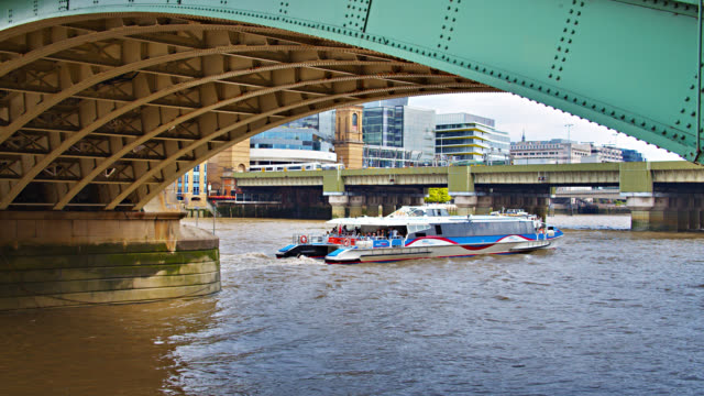 tourist ferry rides under bridge in  london - passenger ship stock videos & royalty-free footage