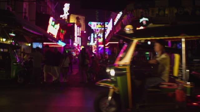 MS Tourist getting in taxi on street at night, Bangkok, Ayuthaya, Thailand