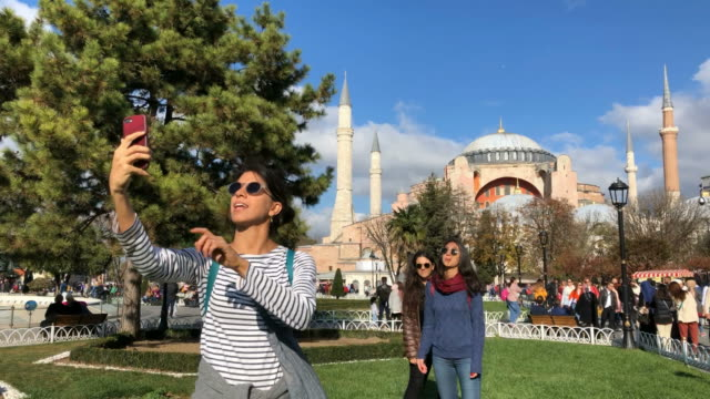 tourist girls making selfies in sultanahmet square, istanbul - istanbul stock videos & royalty-free footage