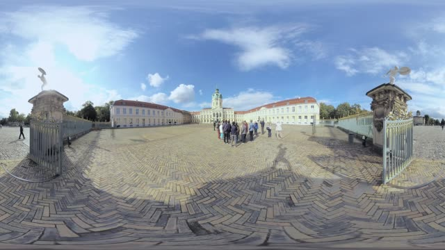 tourist group in front of charlottenburg palcae, immersive city scene, tripod removal. - palace video stock e b–roll