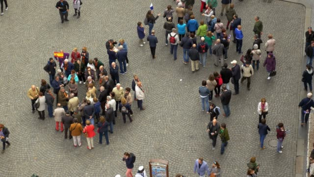 tourist groups meeting in prague old town - square stock videos & royalty-free footage
