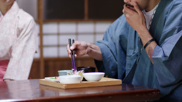 Tourist in a Ryokan eating a traditional Japanese lunch