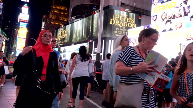 Tourist in Duffy Square Times Square during the summer season, New York City
