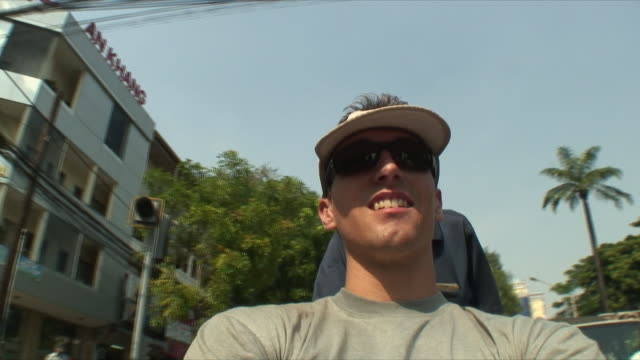 ms pov tourist in rickshaw and locals on bikes, saigon, vietnam - sun visor stock videos & royalty-free footage