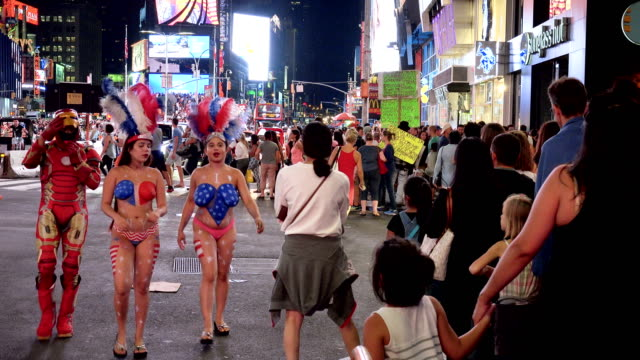 Tourist in Times Square during the summer season, New York City