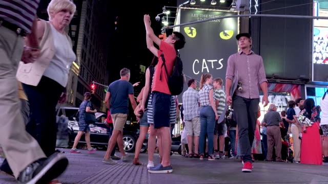 tourist in times square, manhattan new york city - 7th avenue stock videos & royalty-free footage