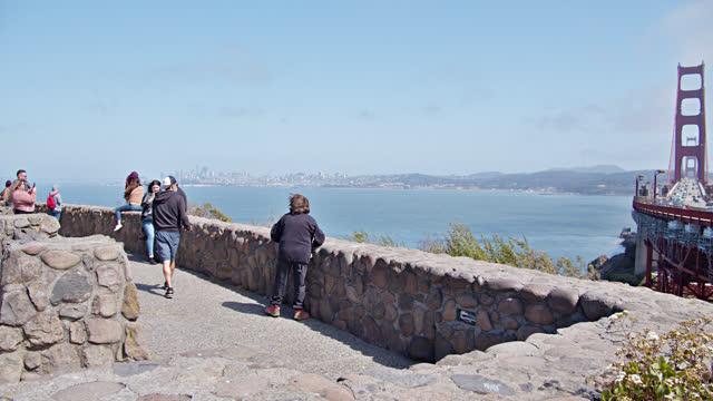 tourist look to golden gate bridge - san francisco bay stock videos & royalty-free footage