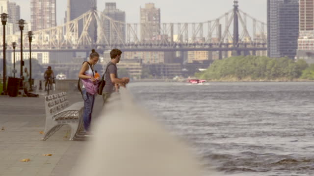 Tourist looking at east river with seaplane in background