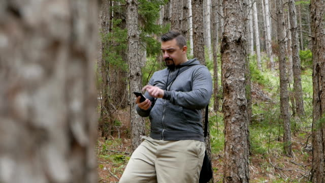 Tourist lost in the woods trying to get phone signal