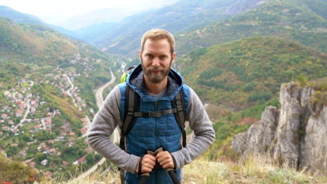 tourist man hiking on the mountain top - environmentalist stock videos & royalty-free footage