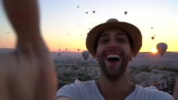 Tourist man taking a selfie on Cappadocia, Turkey