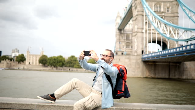 Tourist man taking a selfie