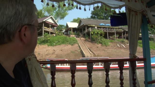 ms tourist on a mekong river ferry boat / luang prabang, laos - 中年の男性一人点の映像素材/bロール