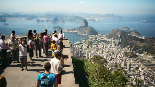 stockvideo's en b-roll-footage met t/l, ws, tourist on observation point looking, rio de janeiro, brazil - latijns amerika