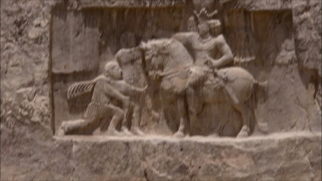 ws ha tu td tourist photographing ancient bas relief, near persepolis, iran - bas relief stock videos & royalty-free footage